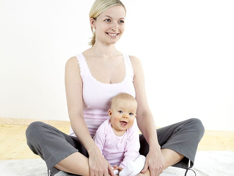 a young mother does physical fitness exercises together with her baby; Shutterstock ID 45514204; PO: 351562321; Client: d3aec677-0cd4-4915-a4d3-11b5d67efc45